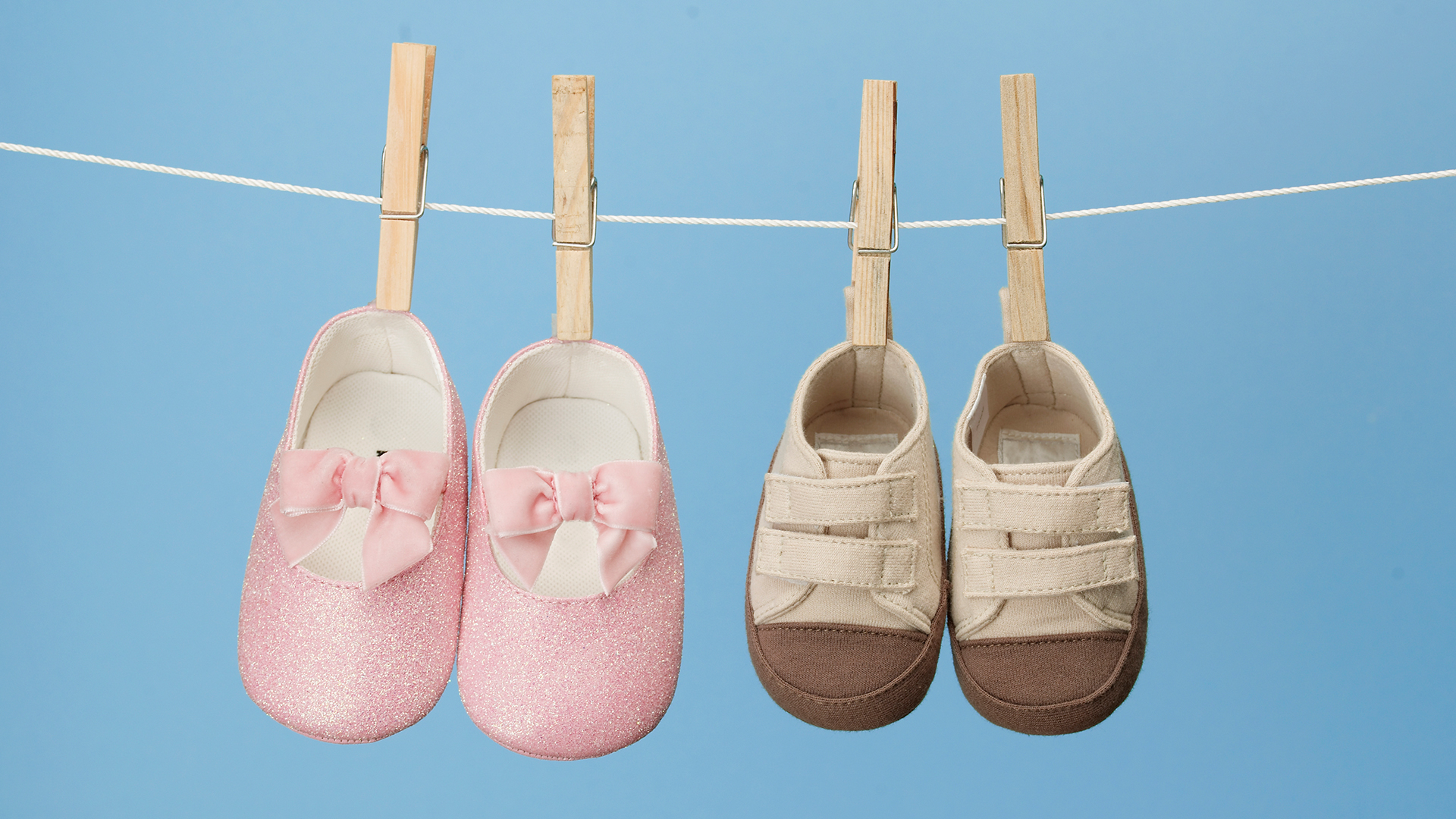 Baby shoes hanging on clothes line | PregnancyAndBaby.com