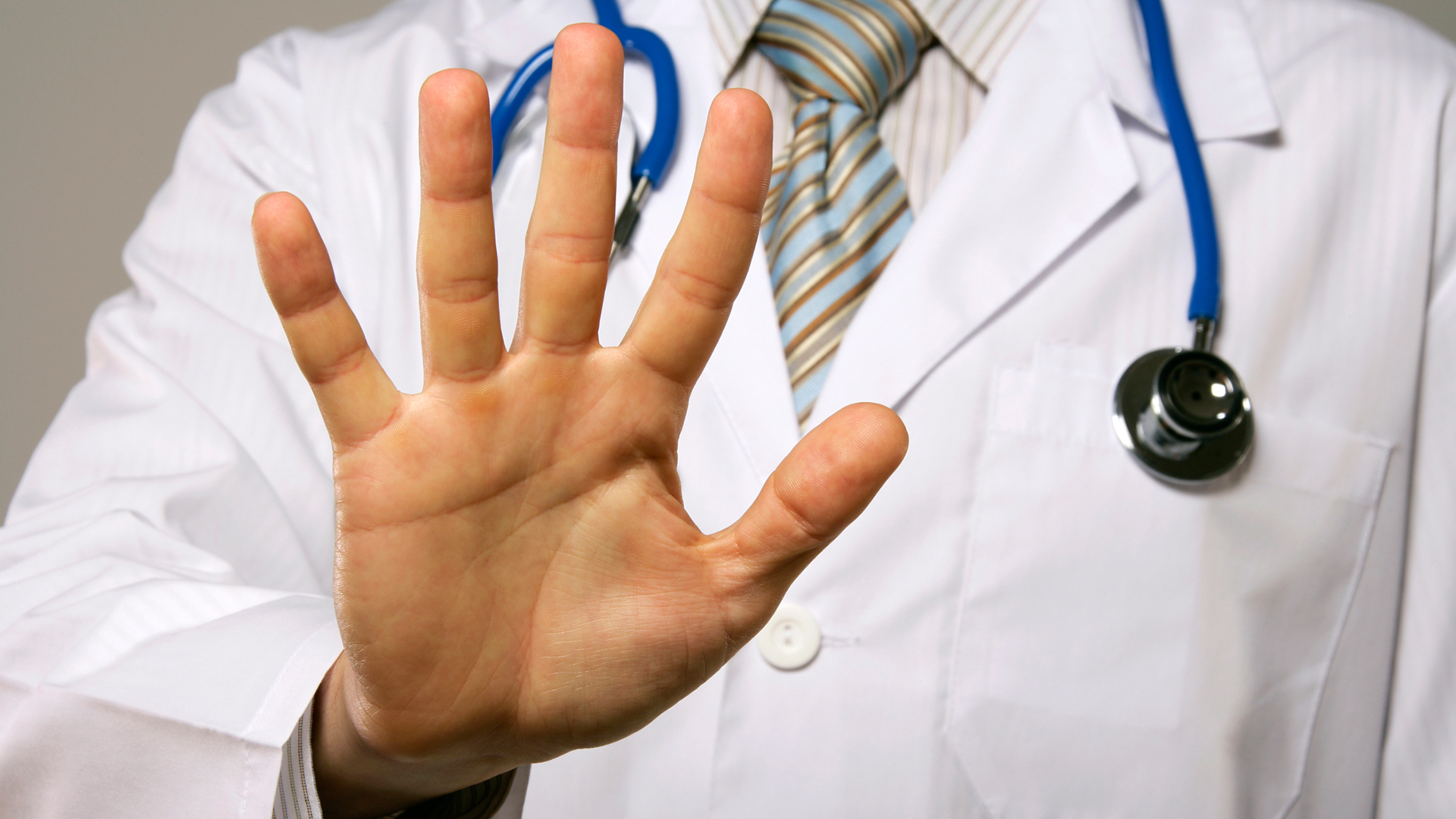 Doctor showing palm | Sheknows.com