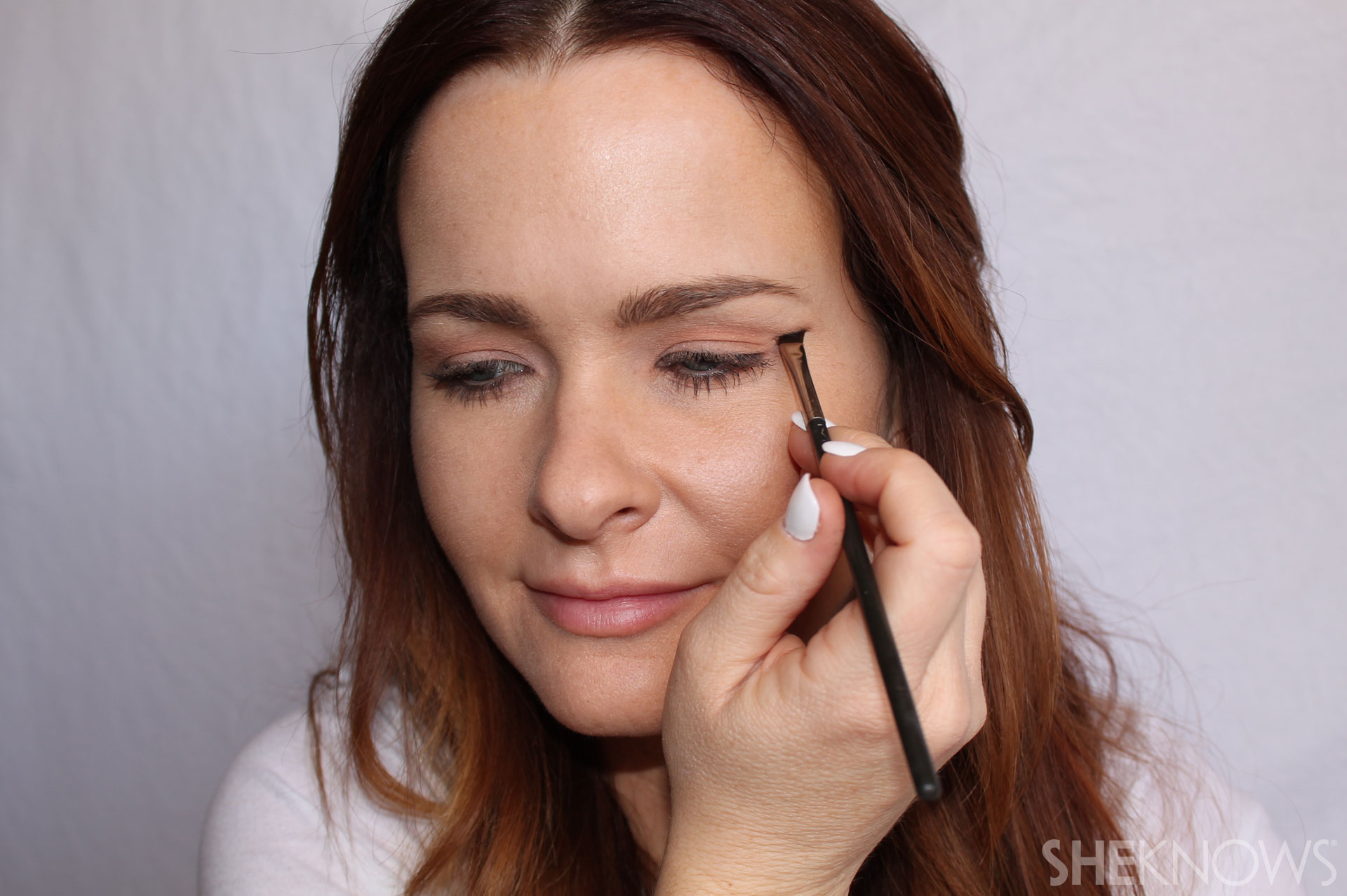DIY Extreme cateye and bold lips: Draw an angled line with black eyeliner