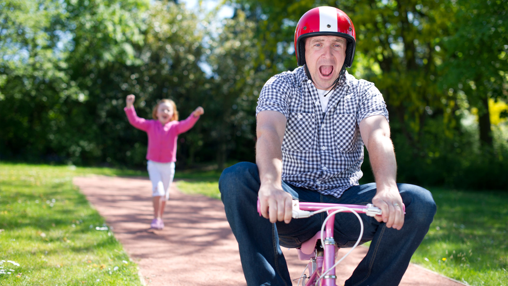 Embrassing Dad on childs bike