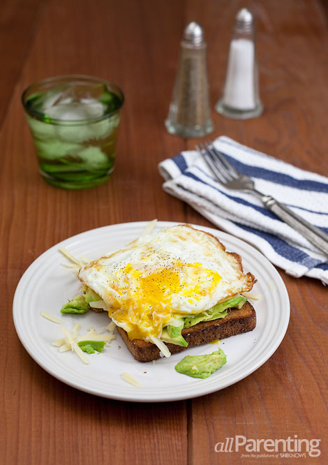 allParenting Fried egg, avocado and gruyere cheese over toast