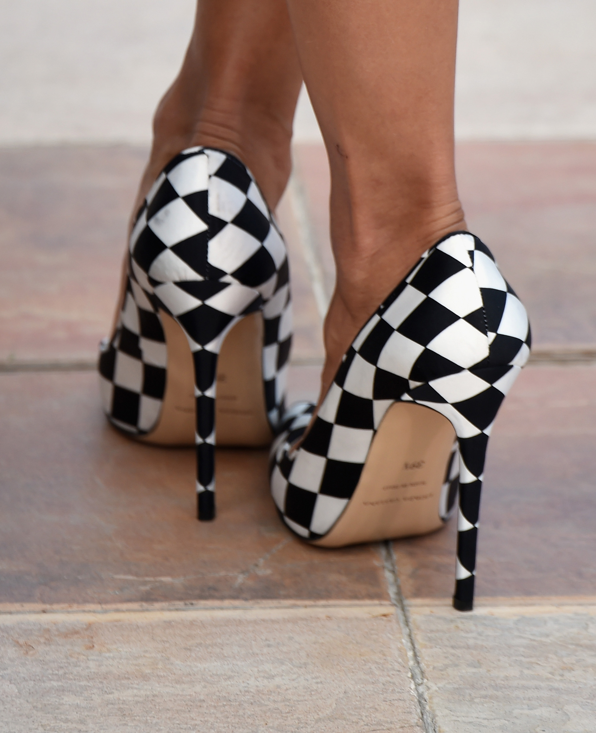 Rosario Dawson's checked shoes at the 2014 Cannes Film Festival