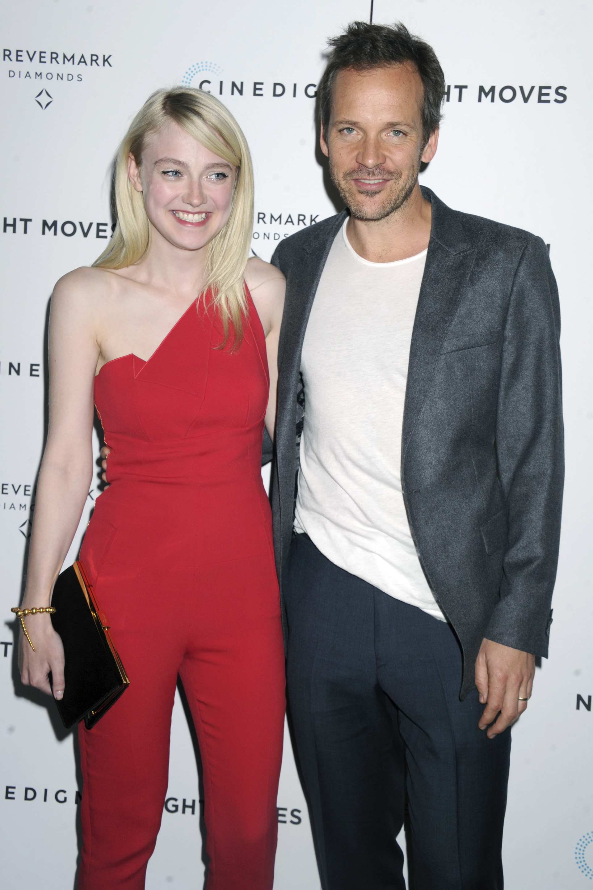 Dakota Fanning New York premiere of her new movie Night Moves wearing a red jumpsuit with Peter Sarsgaard