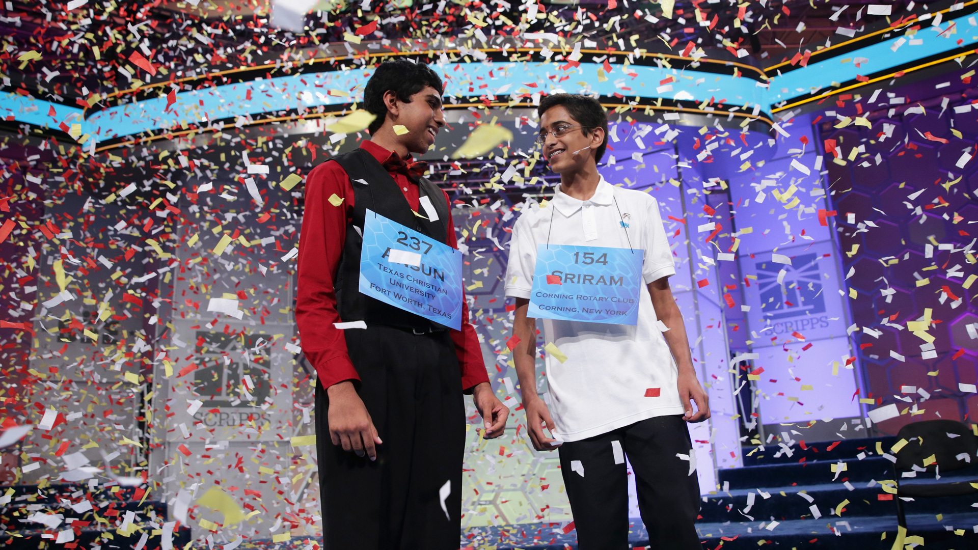 Confetti falls after Sriram Hathwar (R) of Painted Post, New York and Ansun Sujoe (L) of Fort Worth, Texas both won the 2014 Scripps National Spelling Bee competition May 29, 2014 in National Harbor, Maryland. Hathwar and Sujoe were declared as co-champions after 22 rounds of the competition.