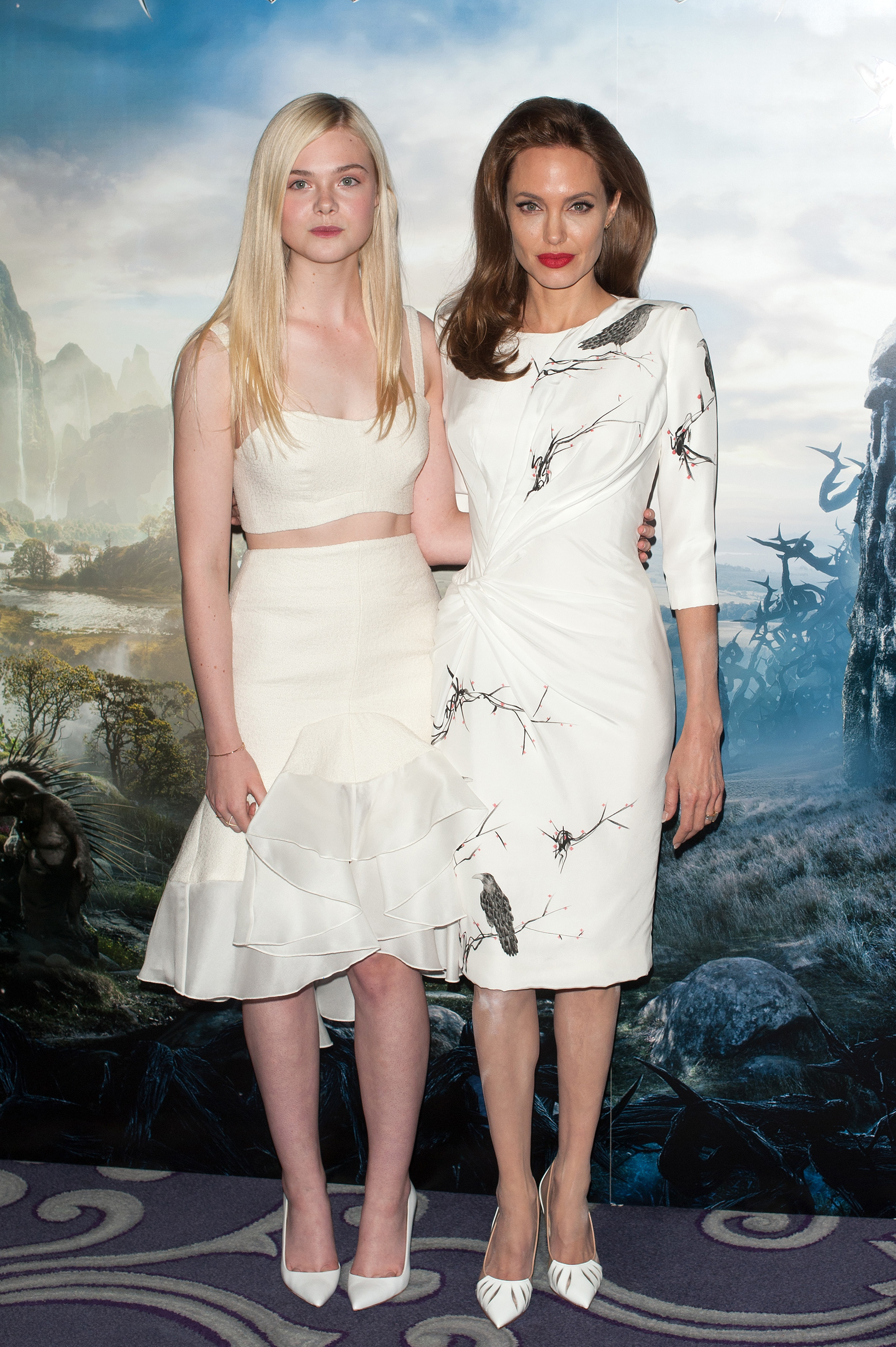 Elle Fanning at Maleficent photo call with Angelina Jolie