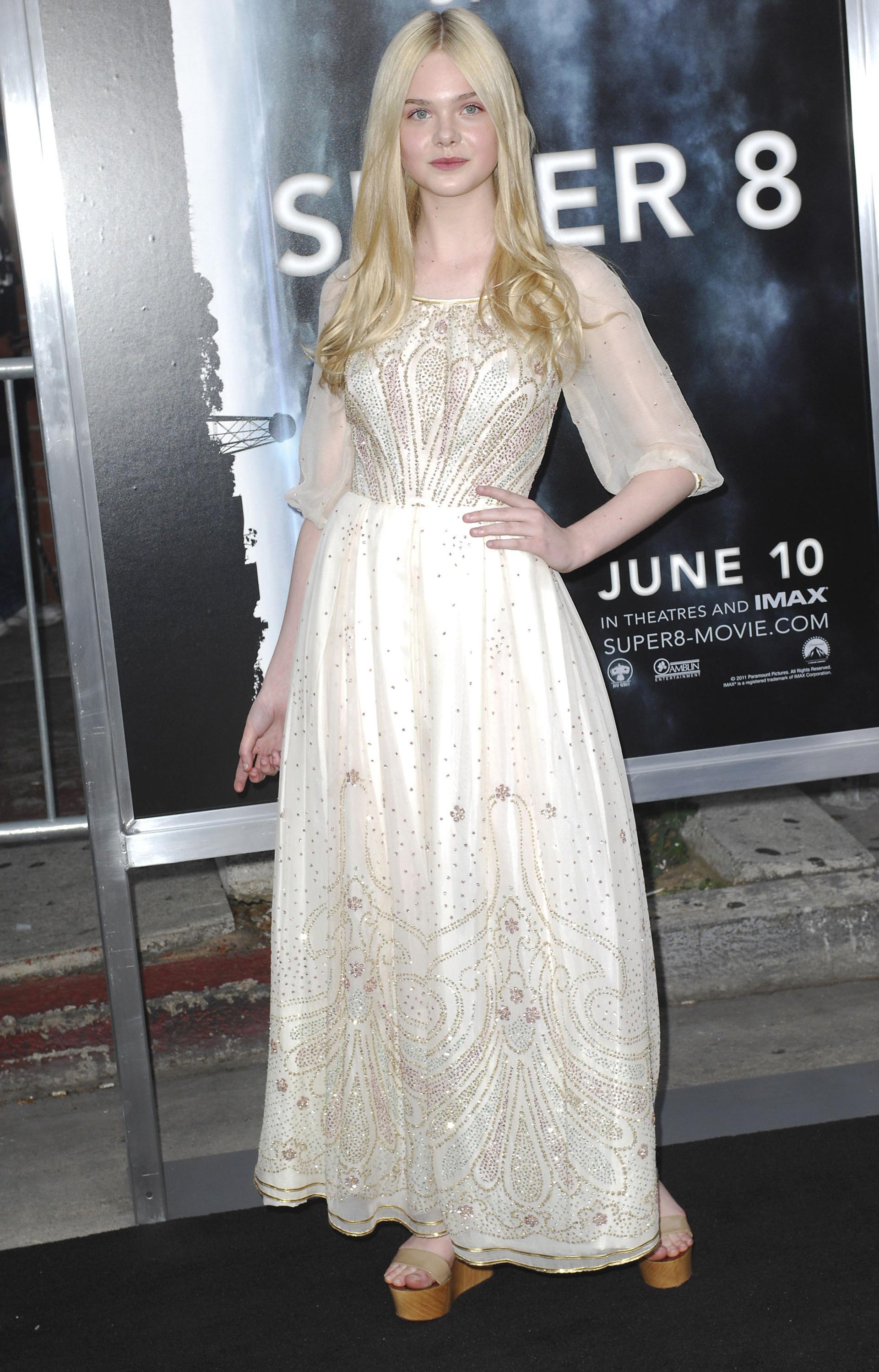 Elle Fanning wearing cream dress to Super 8 premiere