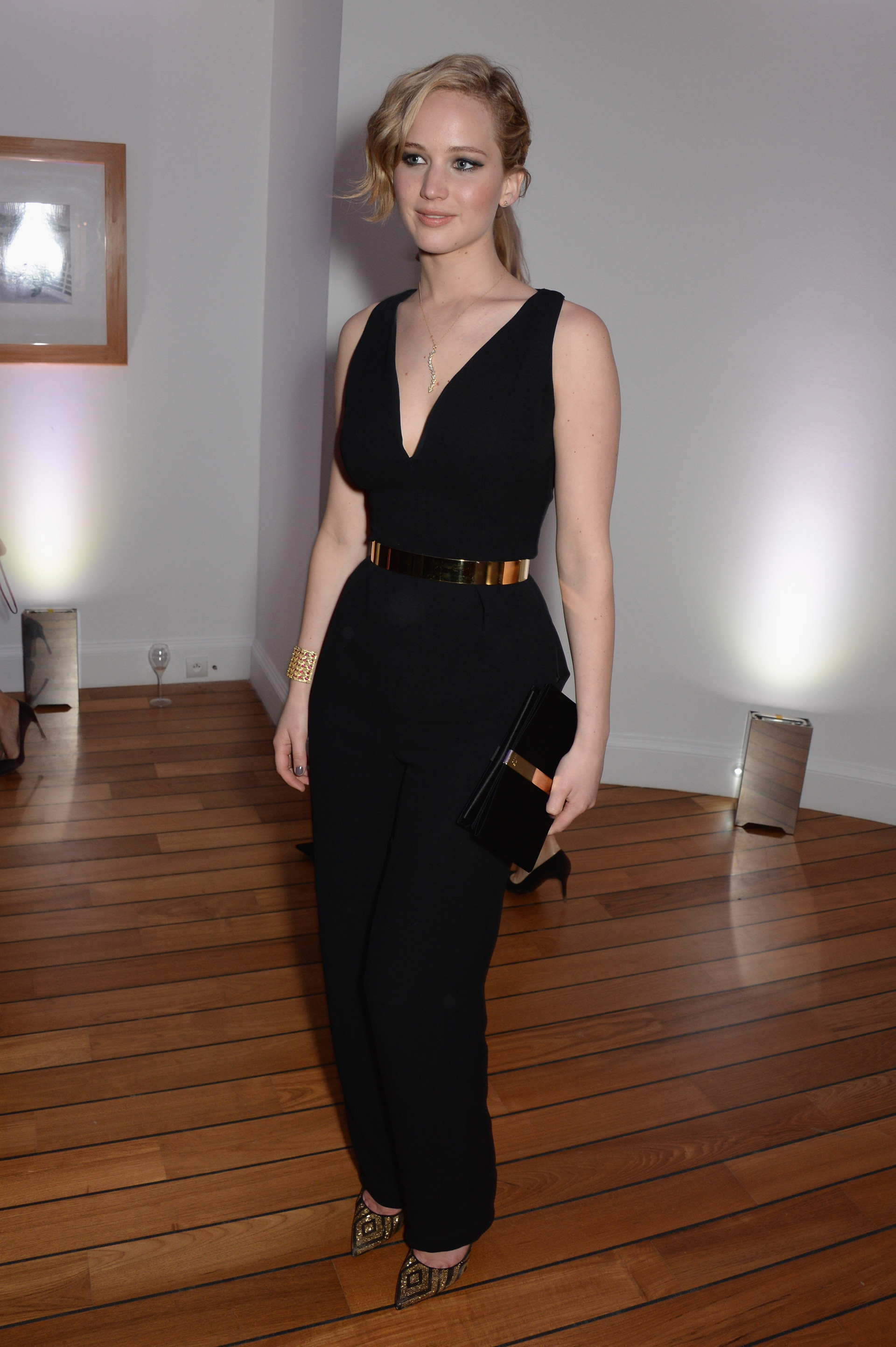 Jennifer Lawrence wearing a black jumpsuit at the Cannes Film Festival Vanity Fair and Armani Party