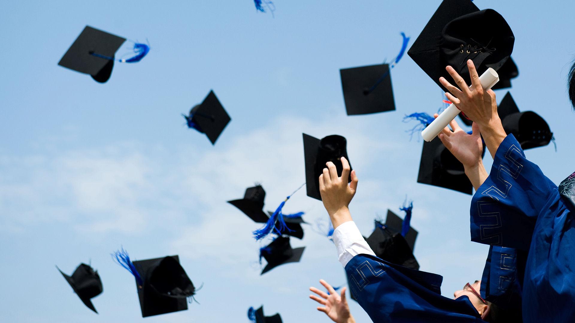 Graduation caps in air | Sheknows.com