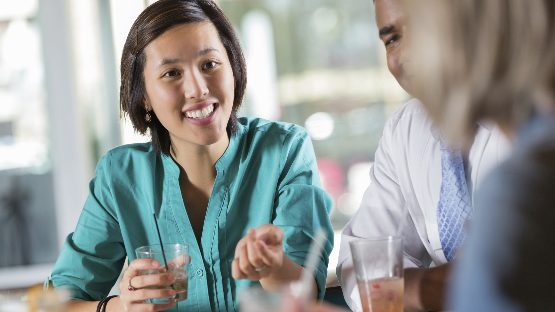 Woman having cocktails with co-workers