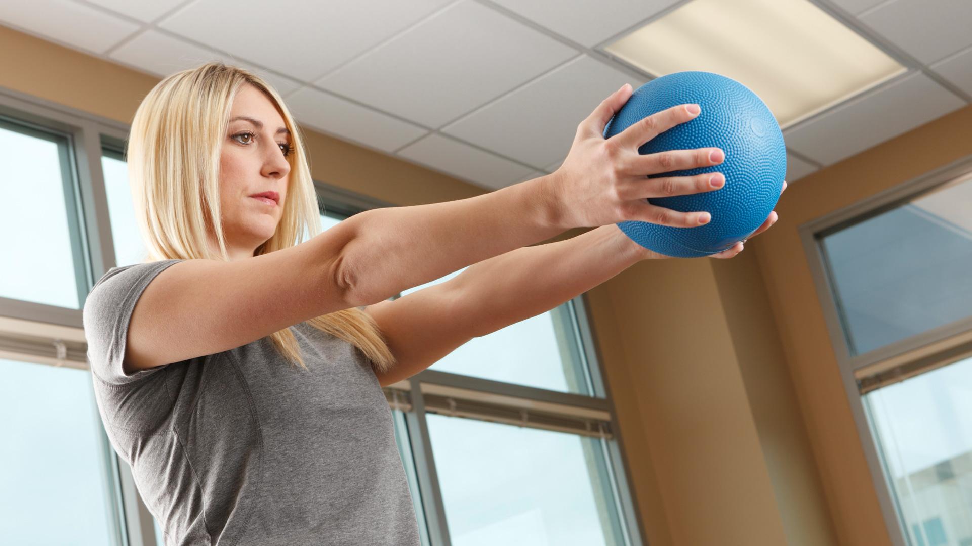 Woman with medicine ball