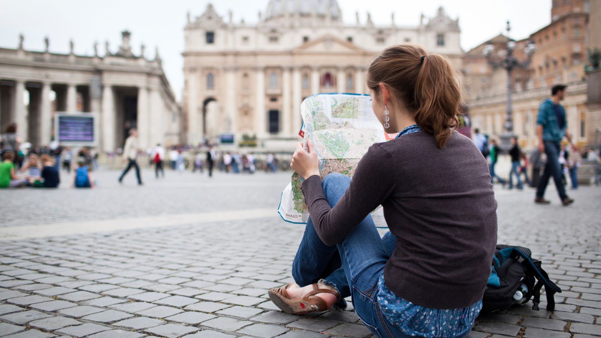 Young woman studying map | Sheknows.com
