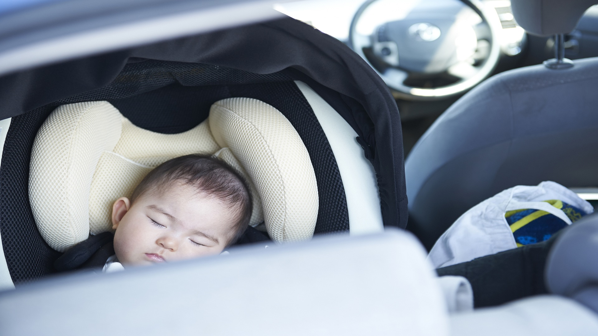 Baby asleep in his car seat