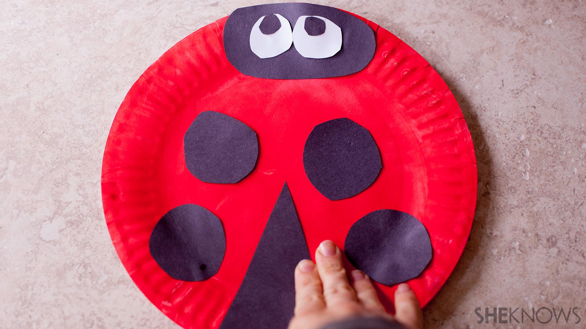 Paper plate fans | Sheknows.com - Ladybug: Step 2