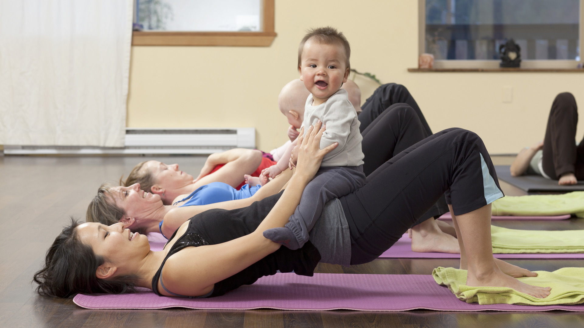 Mother doing yoga with baby | PregnancyAndBaby.com
