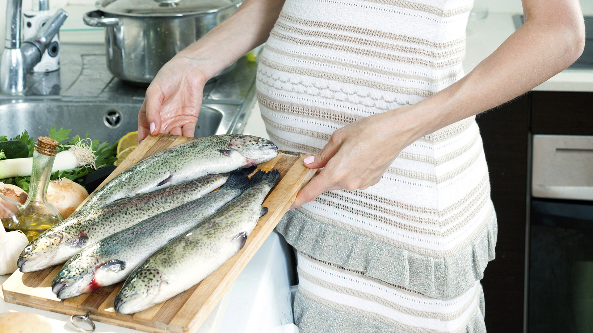 Pregnant woman with fish | PregnancyAndBaby.com