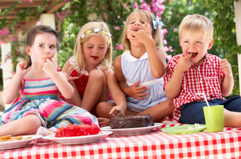 Kids eating cake at a party