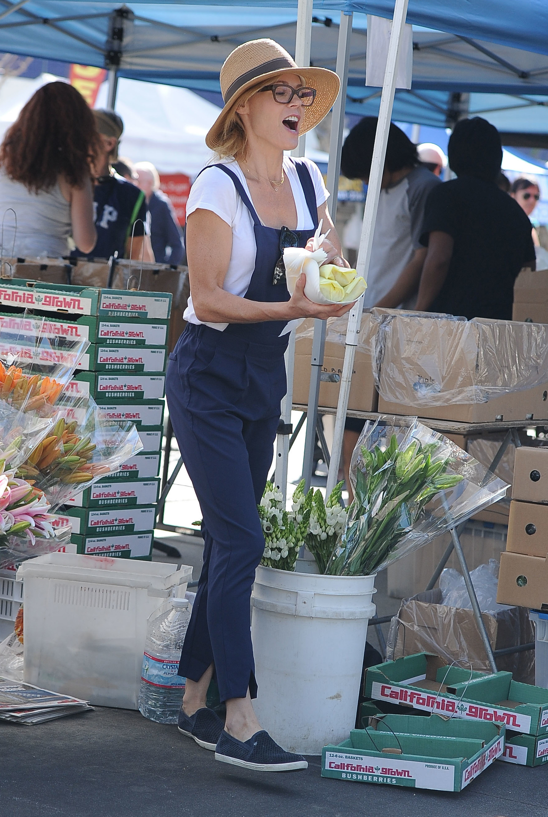 Julie Bowen wearing overalls
