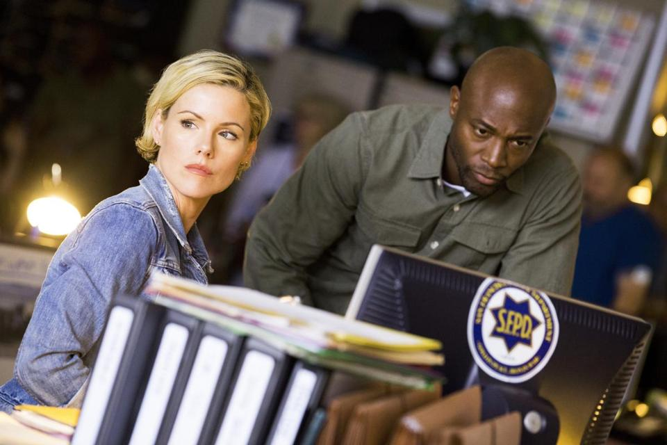 Kathleen Robertson and Taye Diggs in Murder In The First