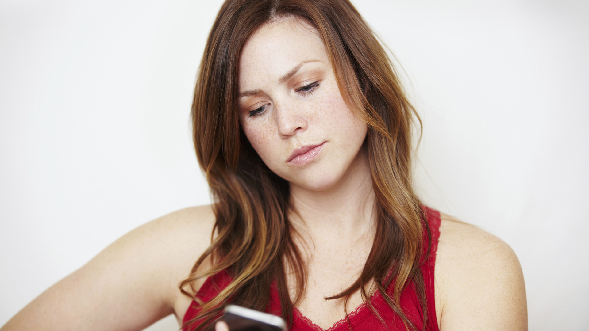 Annoyed woman looking at smartphone