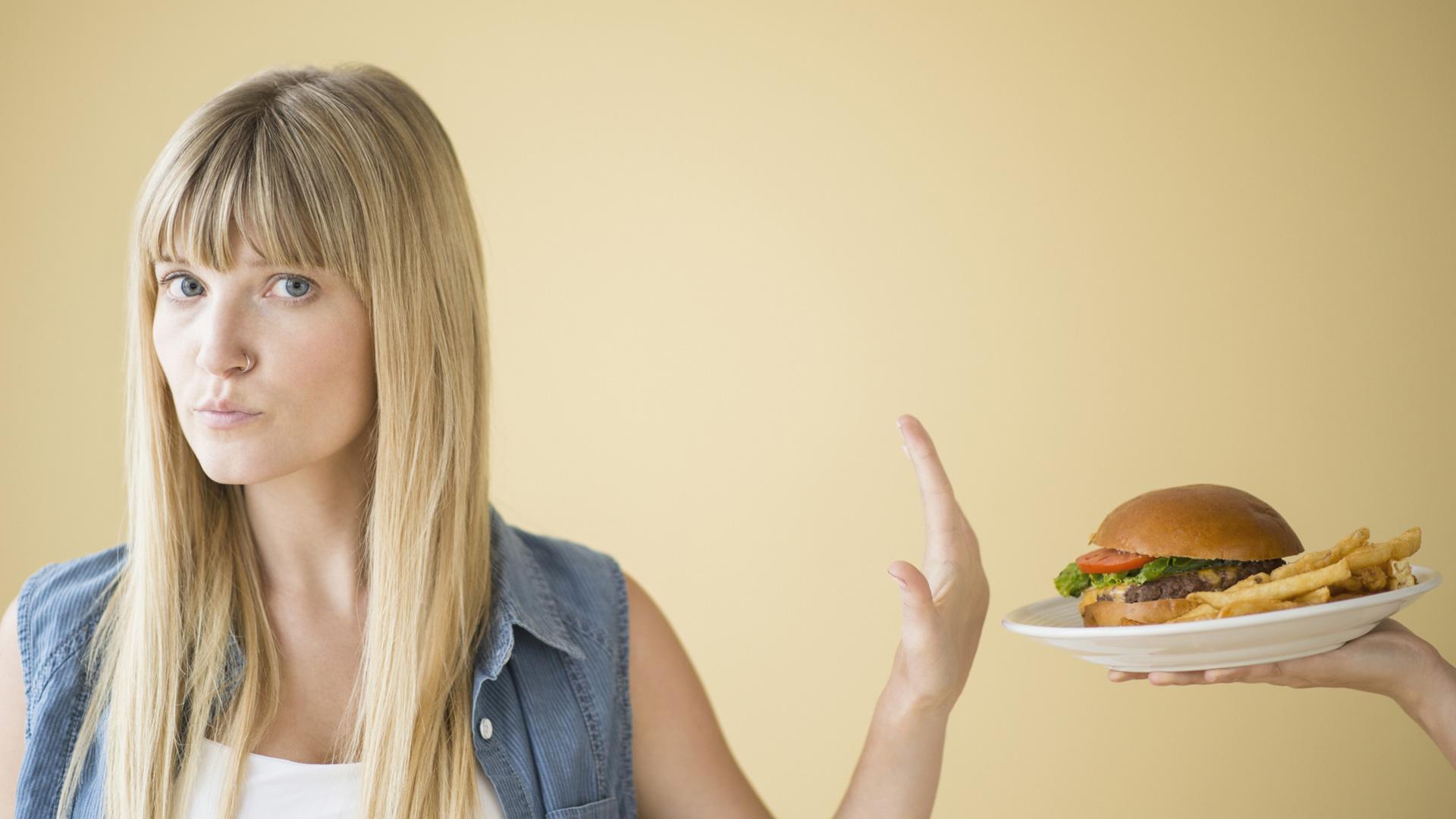 Woman saying no to hamburger