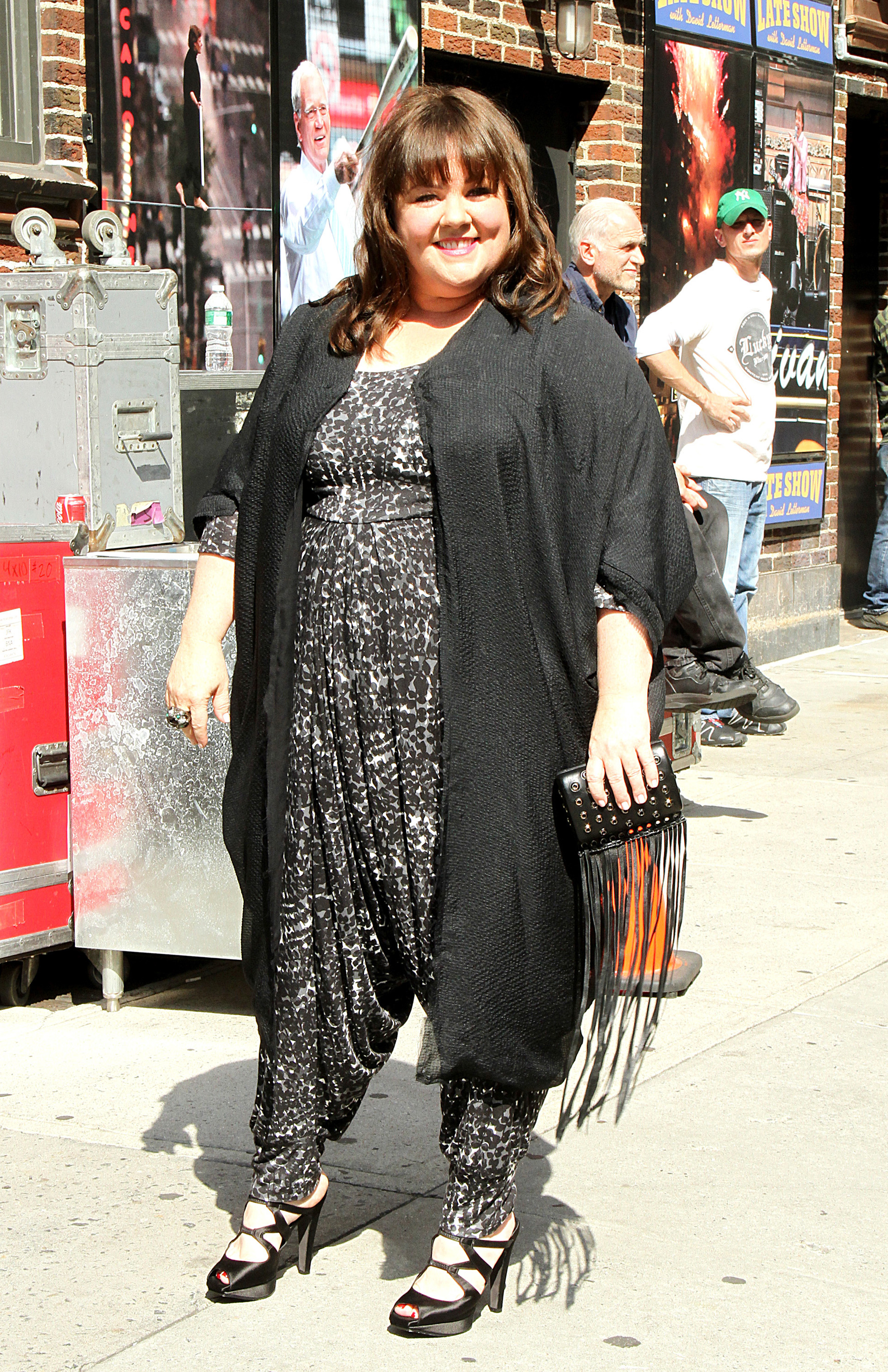 Melissa McCarthy wearing a jumpsuit