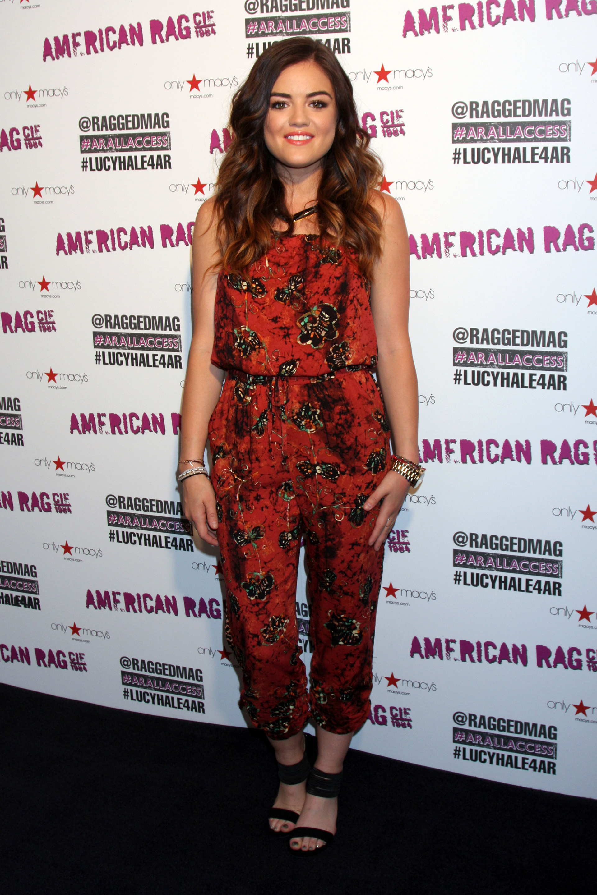 Lucy Hale wearing a jumpsuit