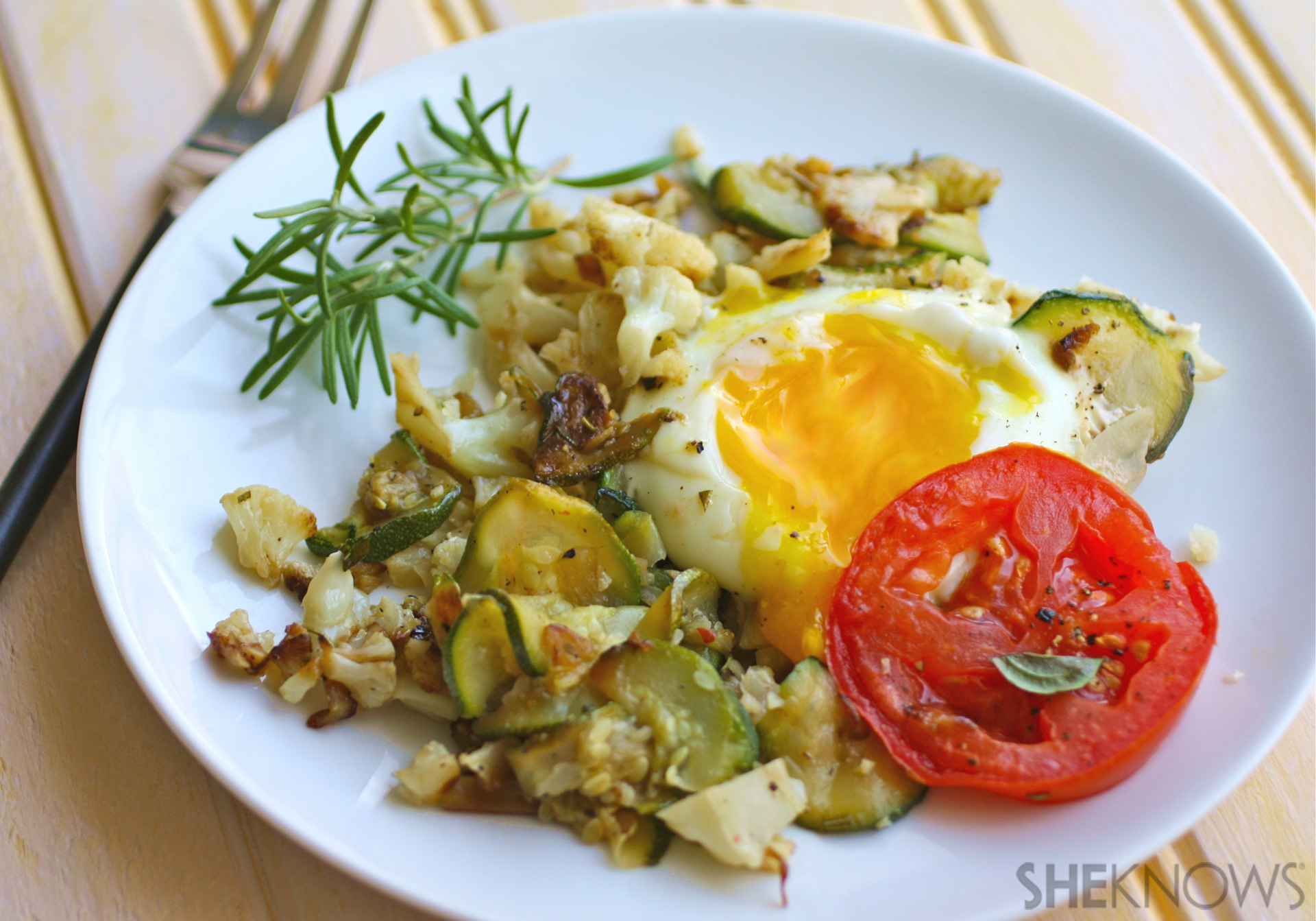Skillet cauliflower and zucchini hash with eggs