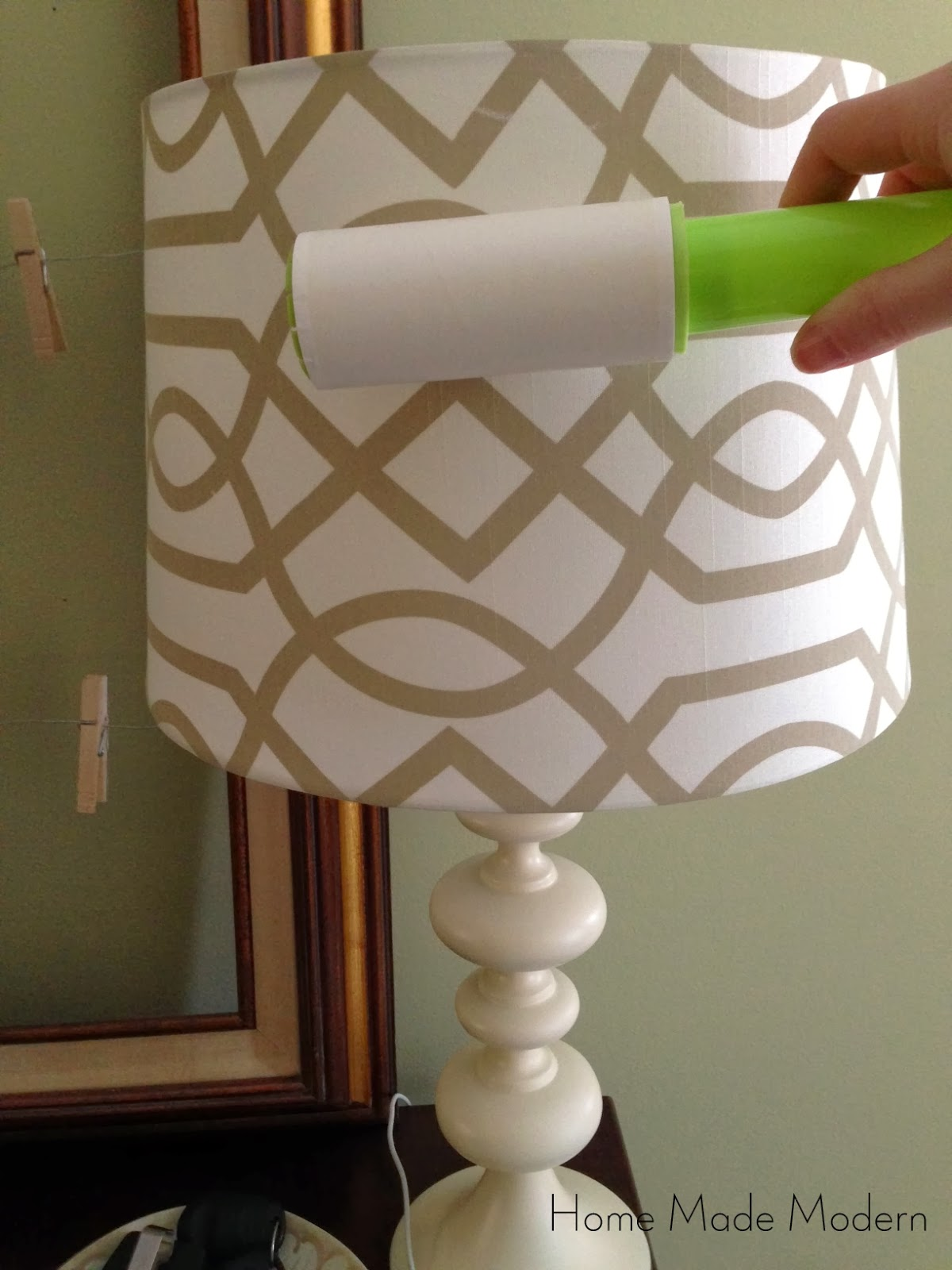 Dust lamp shades with a lint roller