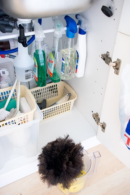 Use tension rods to organize cleaners