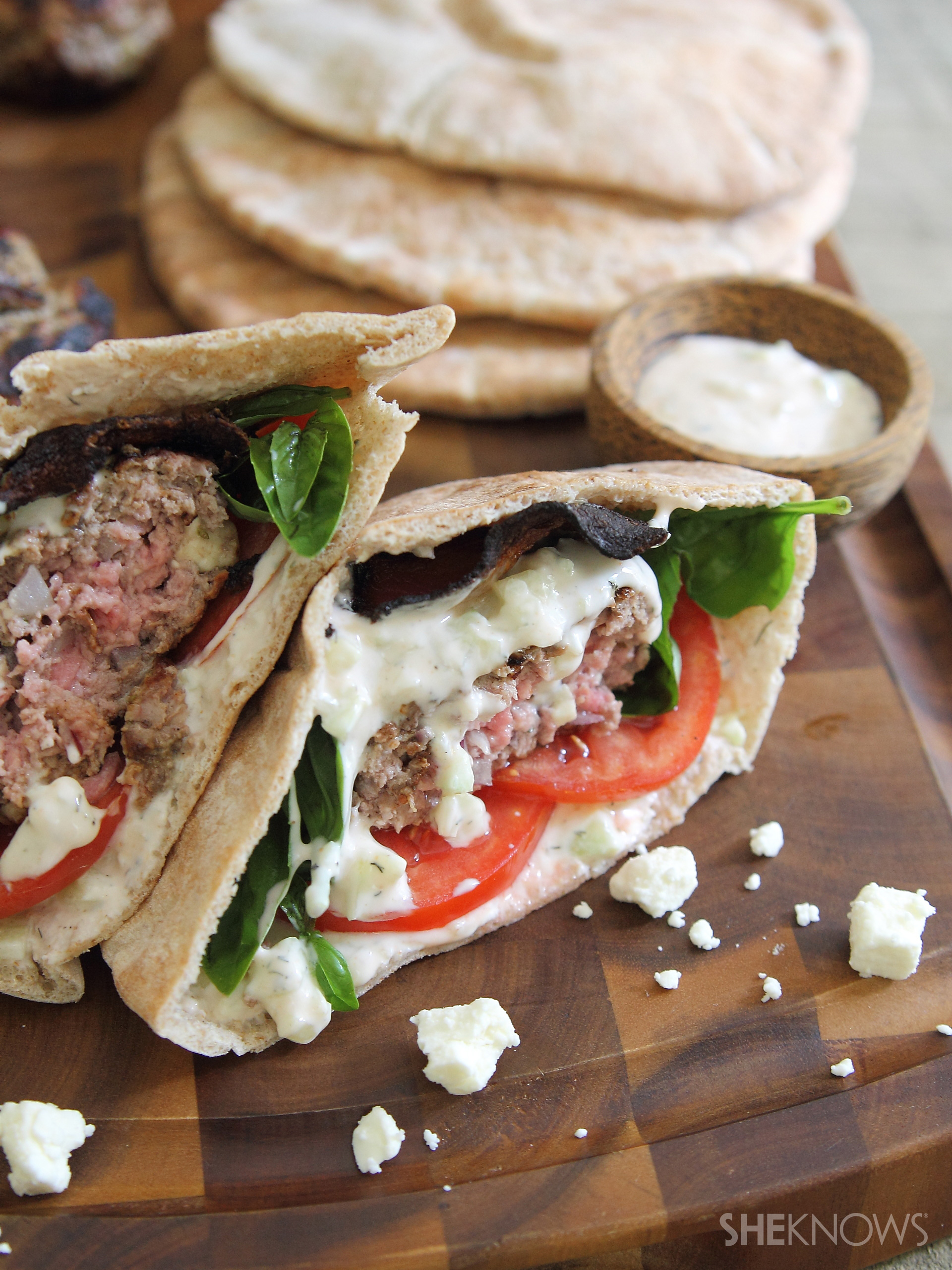Greek-style burgers stuffed with feta sounds good, right? Now add bacon. Cue the drool.