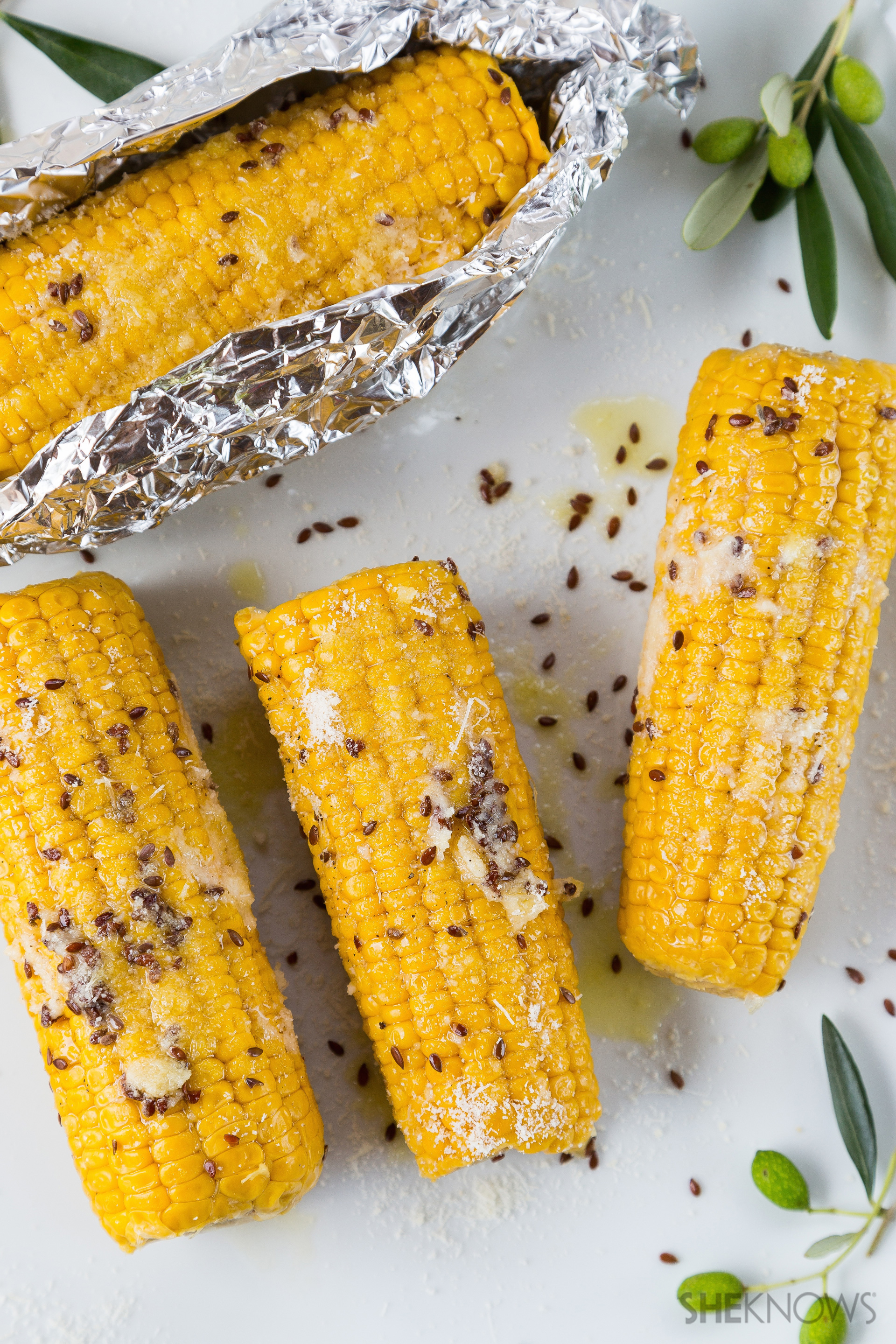 Guiltless baked corn on the cob with Parmesan and flaxseeds is the ...