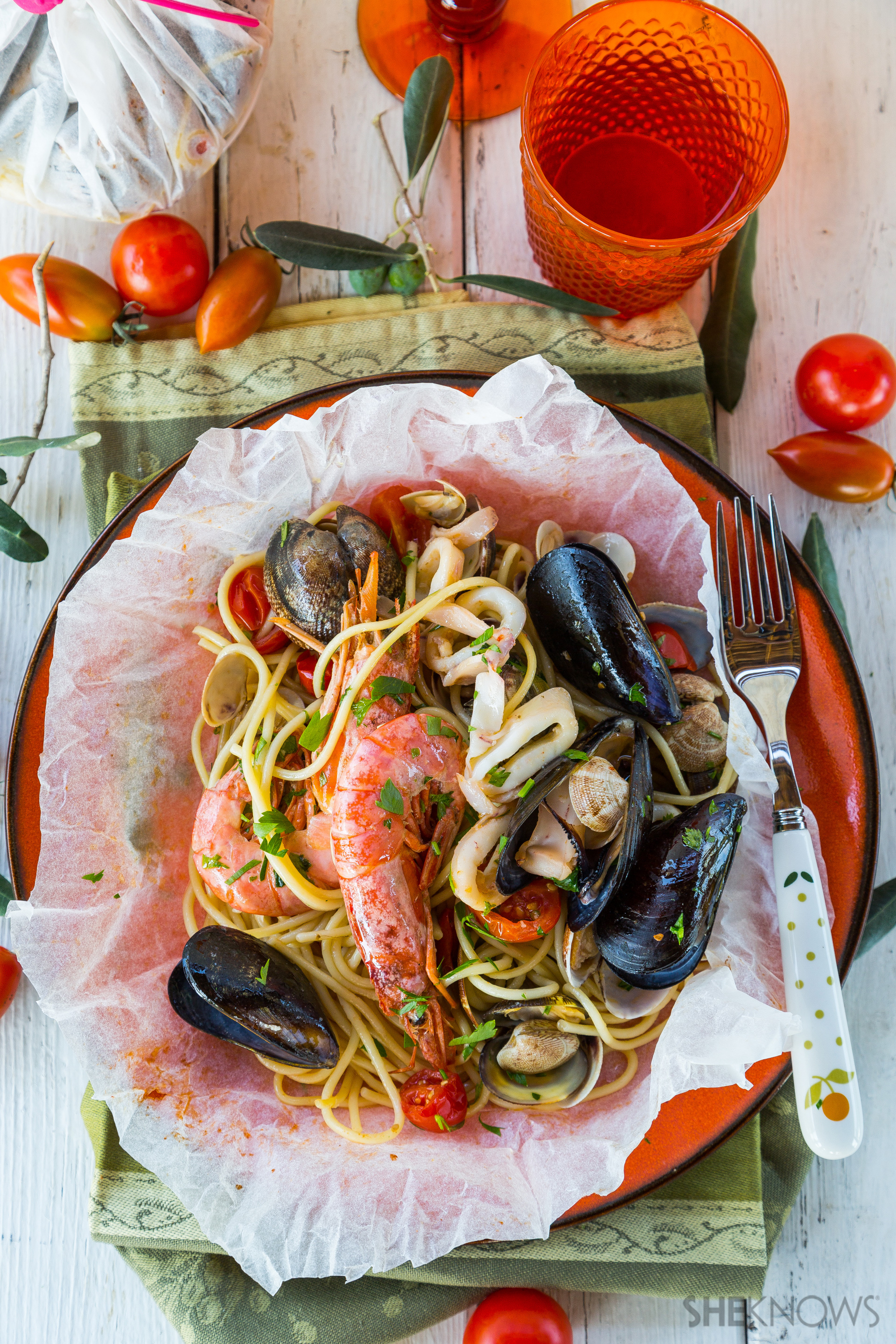 Spaghetti with seafood baked in parchment pouch recipe