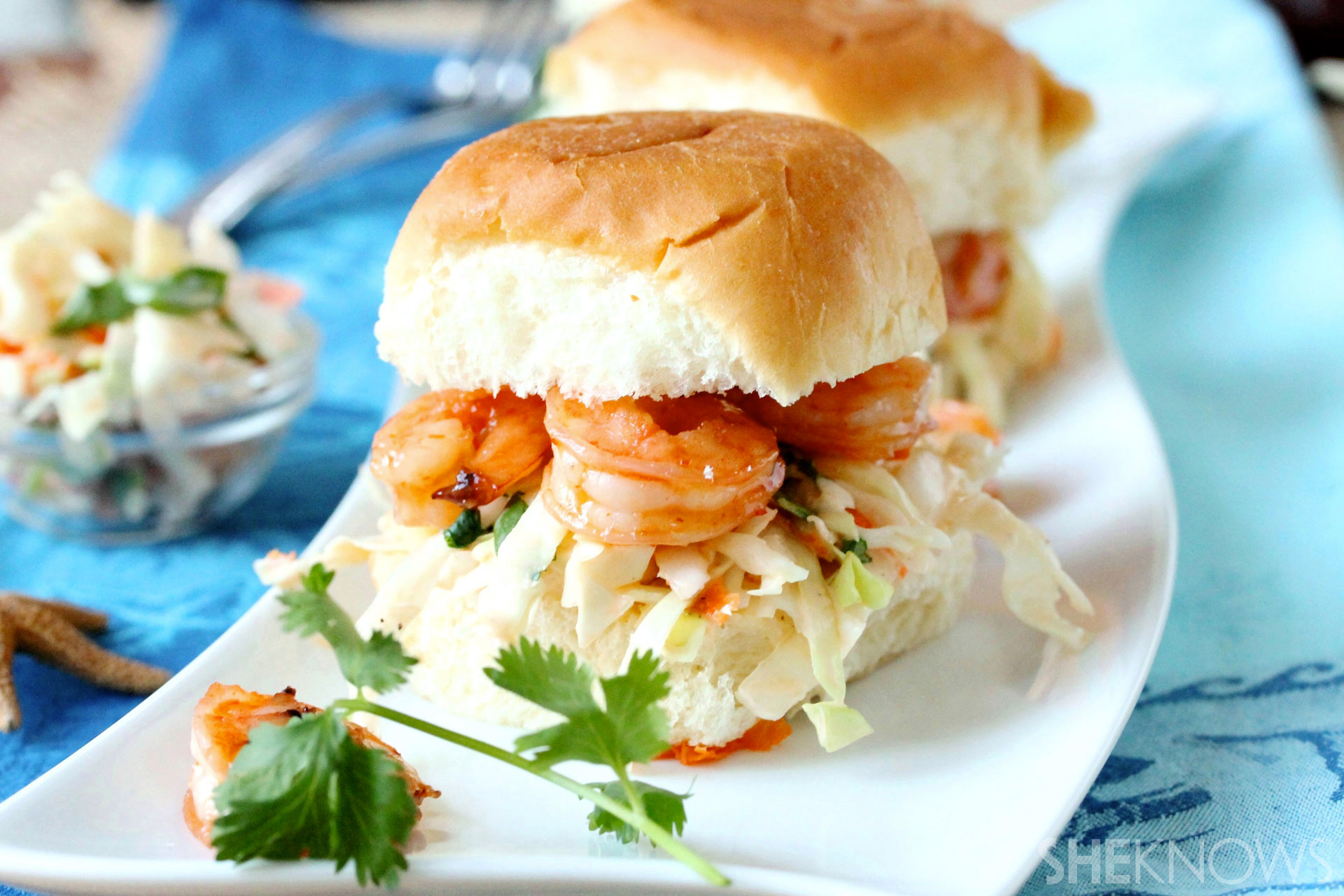 The perfect end-of-summer appetizer comes in the form of cole slaw-topped shrimp sliders