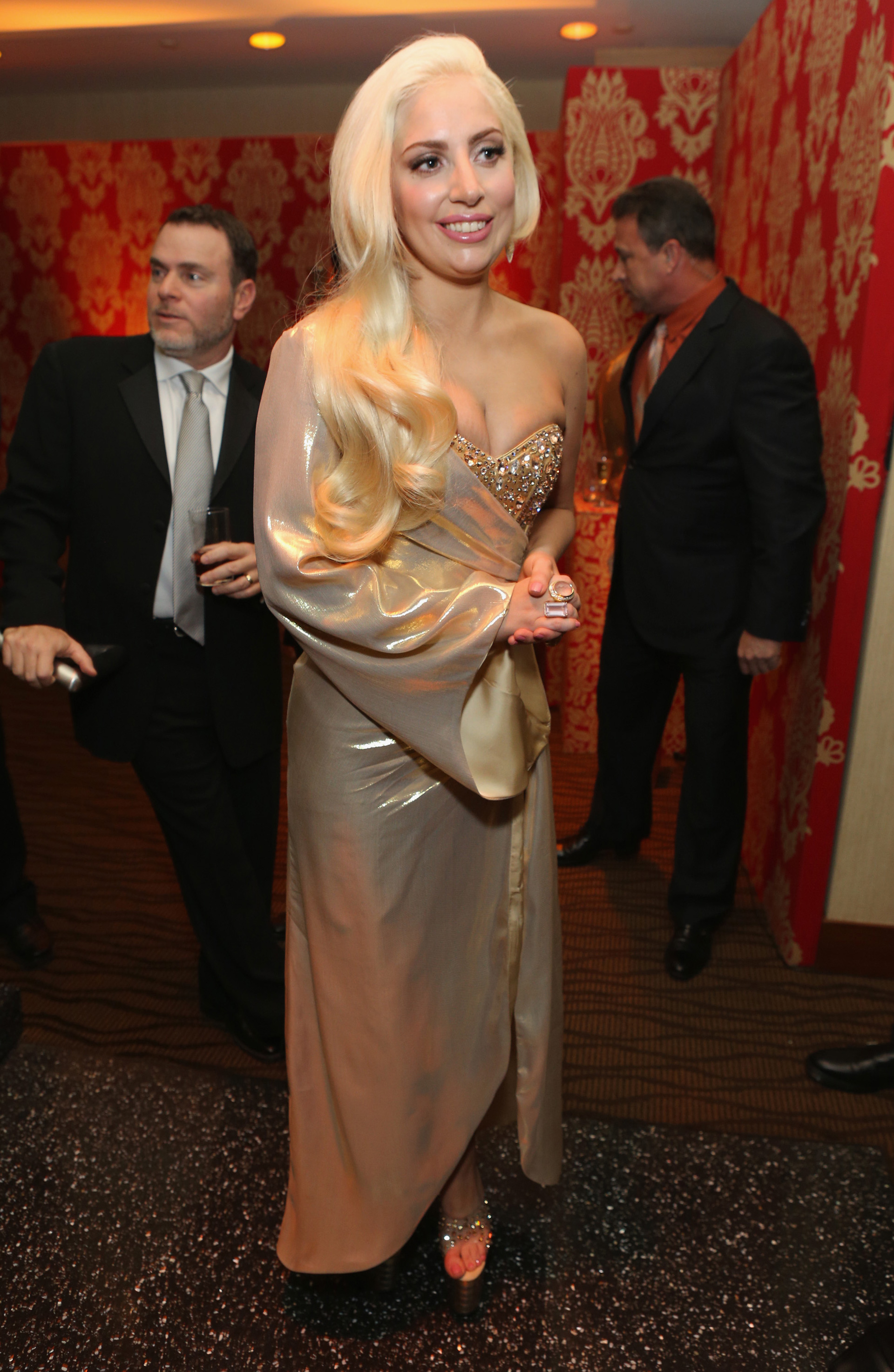 Gaga in a gold one sleeve metallic gown
