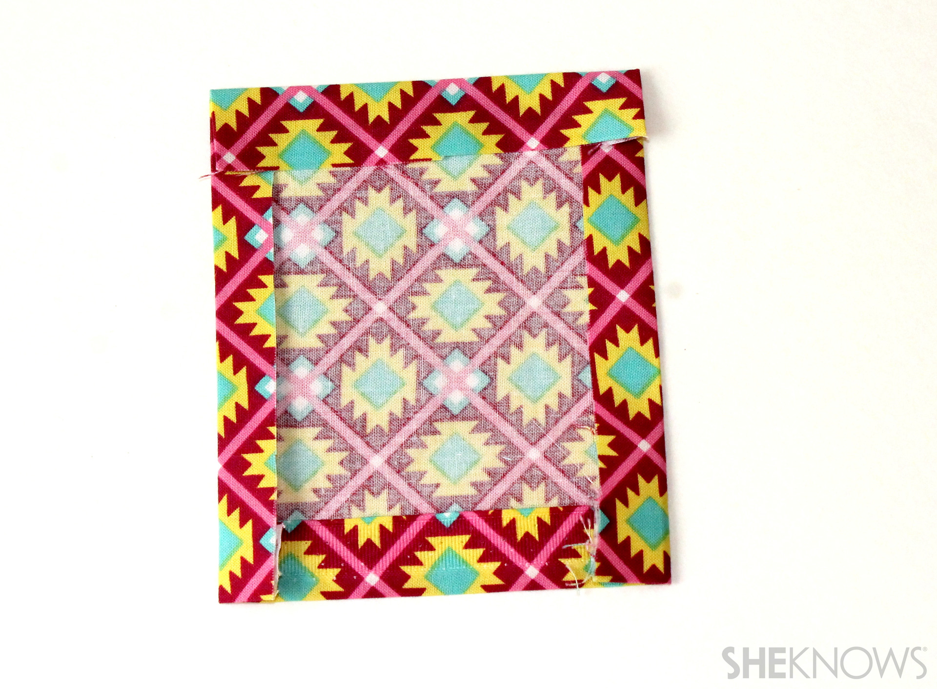 fabric covered composition book: Prepare the pocket by turning each edge under
