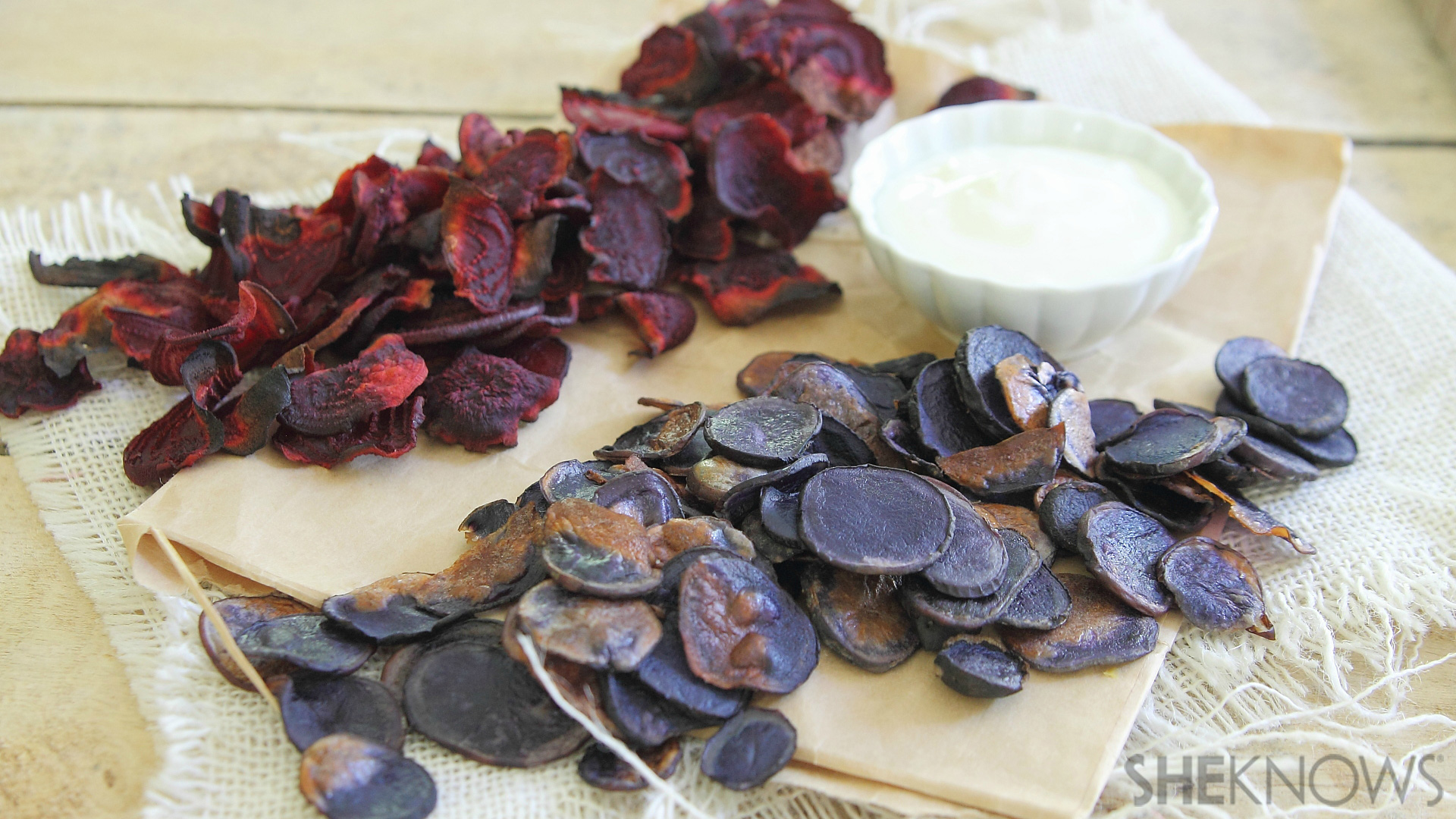 Red beet and blue potato chips with yogurt dip