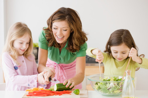 Mother and daughters preparing dinner