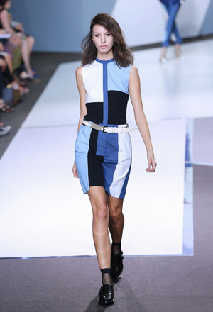 Fashion Week model wearing a color blocked outfit