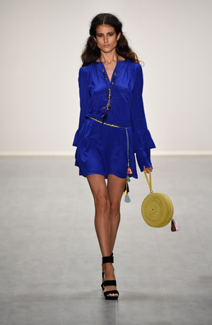 Fashion Week model wearing a blue primary color dress