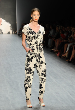 Model at Fashion Week wearing a floral print jump suit