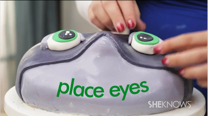 Place the eyes on the top of the shark themed cake
