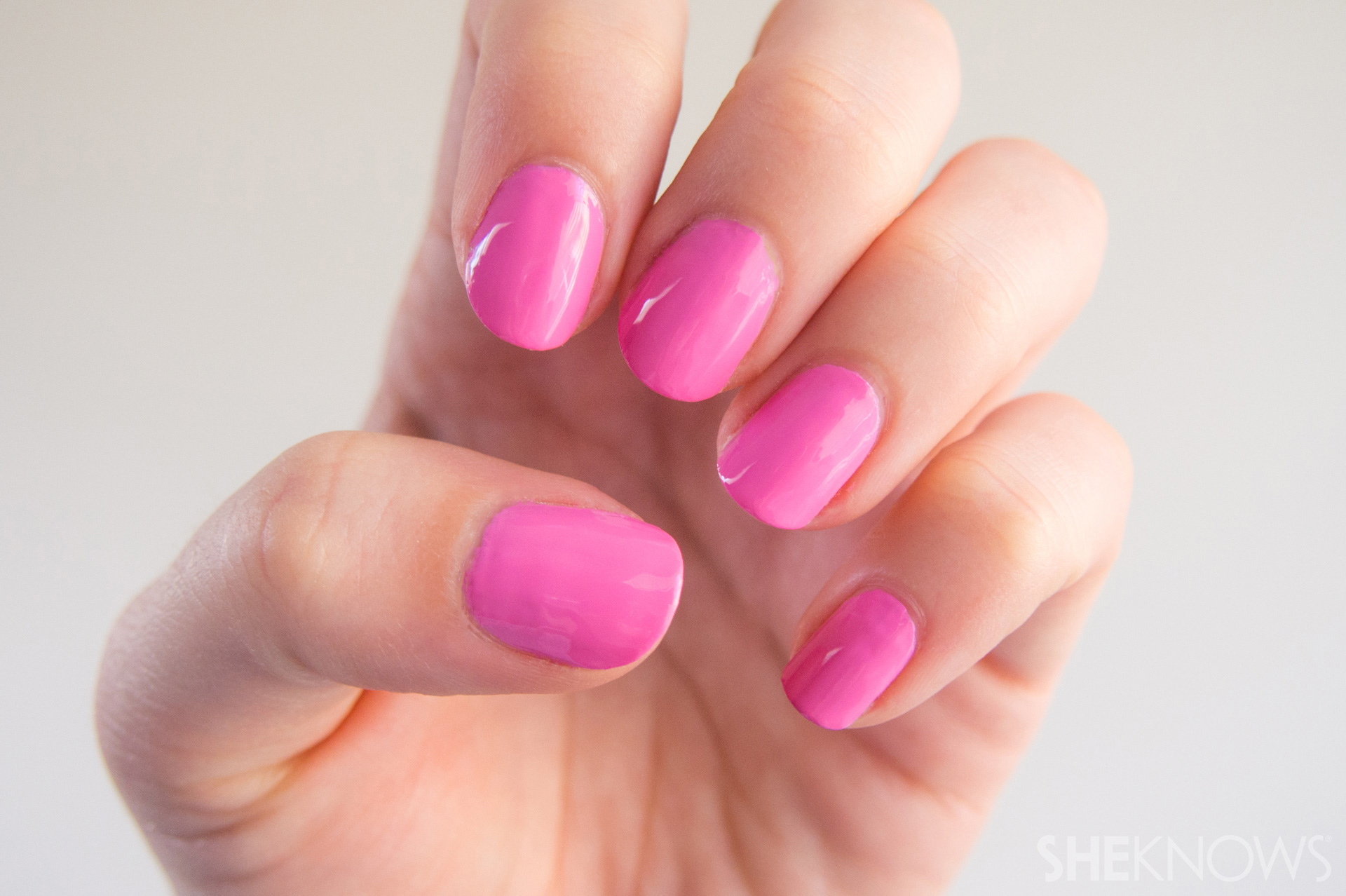 Nail design Pink camo print: Step 1: Begin with a pink base coat.