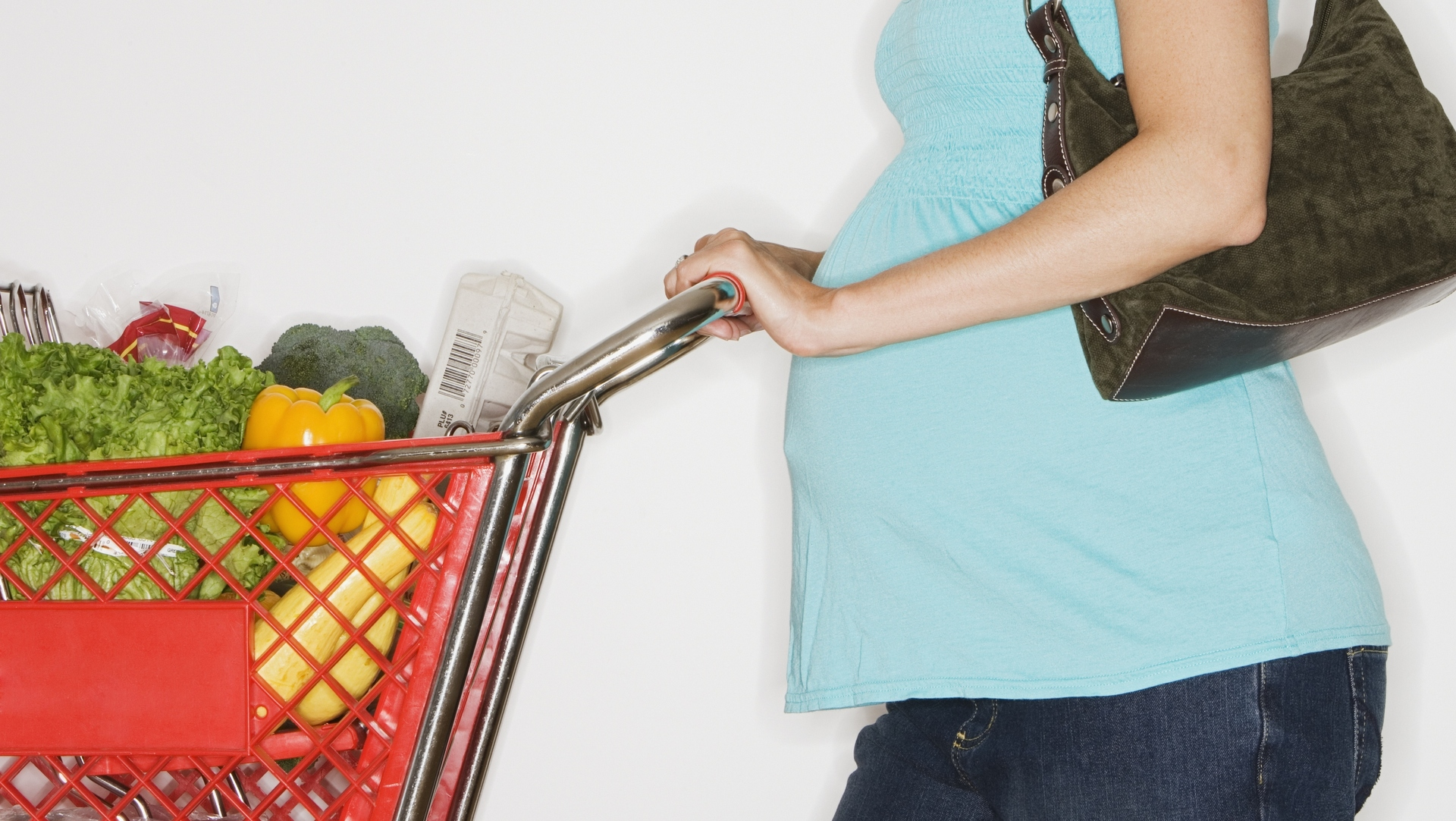 Pregnant woman with groceries