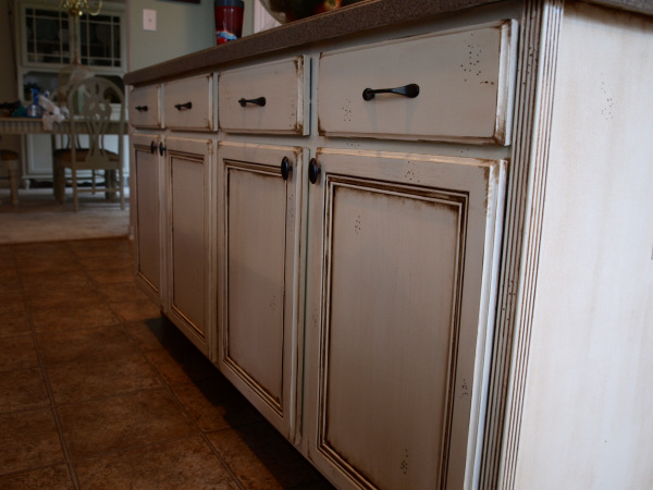 11 inexpensive ways to revamp your kitchen cabinets for Refinishing old kitchen cabinets