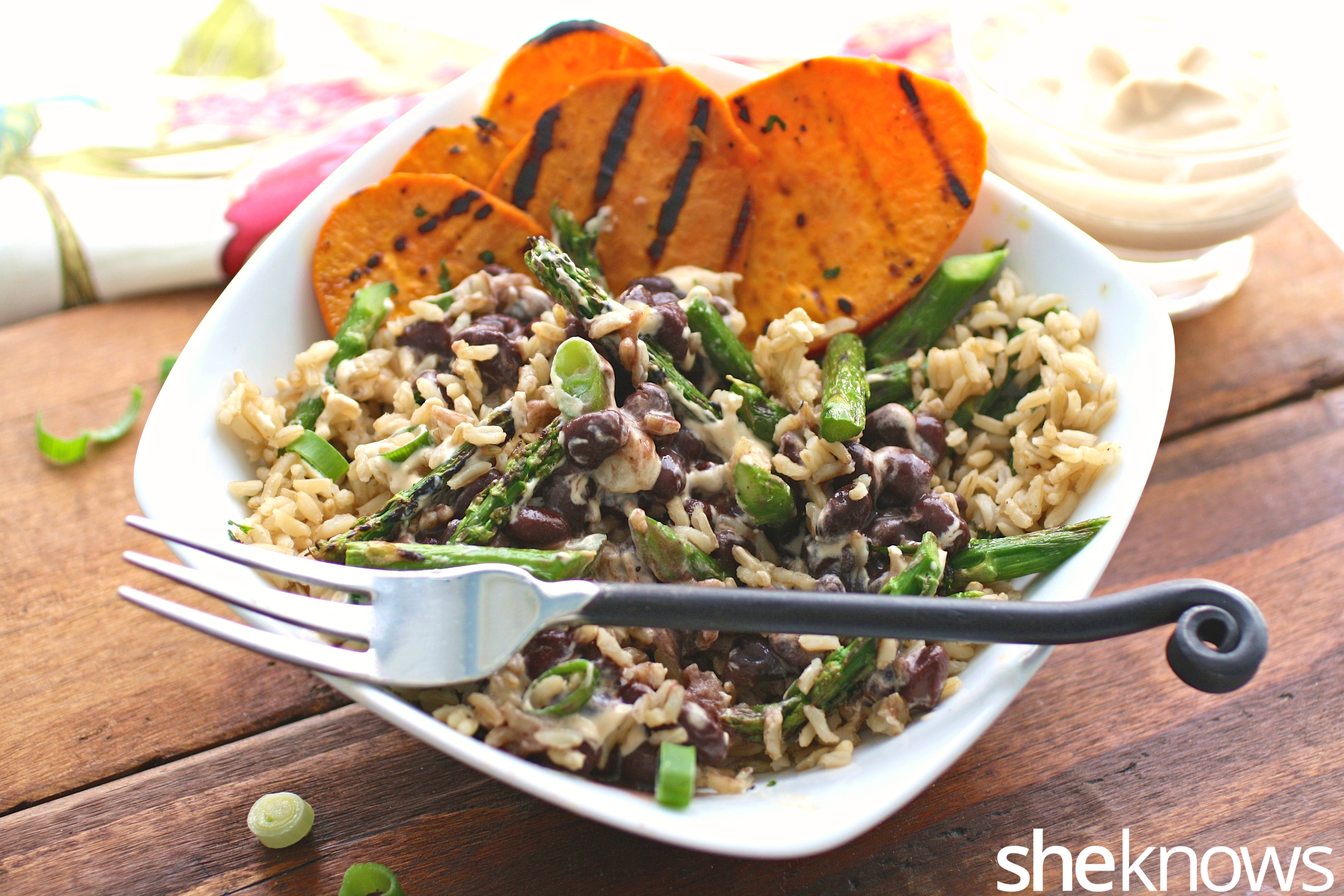 Grilled sweet potato and asparagus brown rice bowl with spicy cashew ...