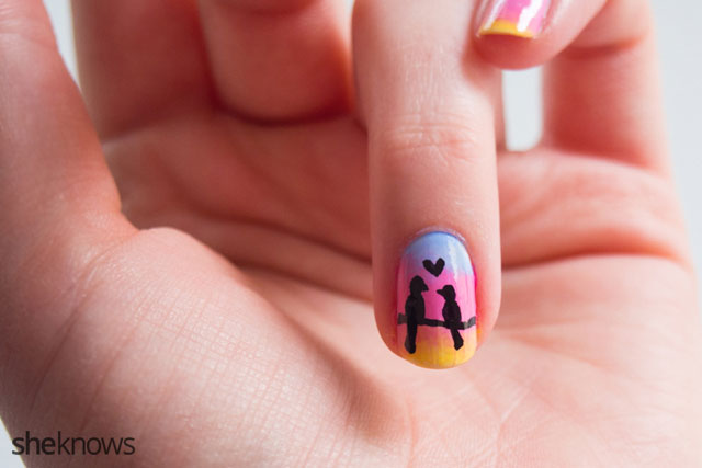 A romantic Valentine's Day nail design features adorable love birds doodle