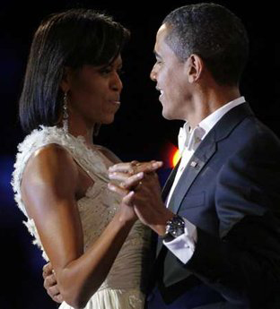 Michelle dancers with her man, our President