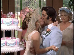 Emily Proctor kisses David Schwimmer in Breast Men