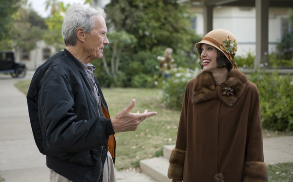 Eastwood and Jolie share a light moment on the set of The Changeling