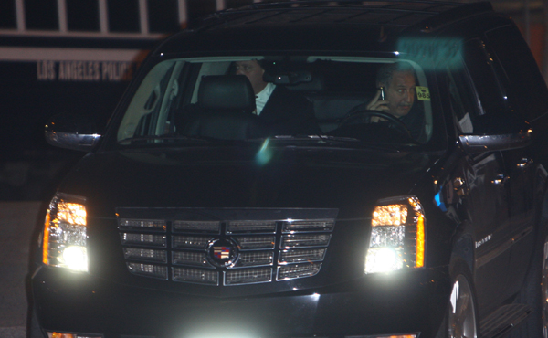 Chris Brown (in back left seat) leaves the LAPD